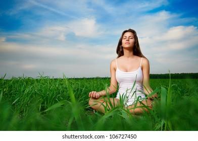 beautiful girl relaxing in a field