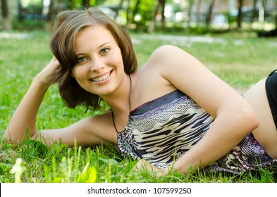 beautiful girl relaxing on a meadow