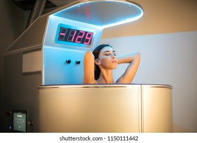 Beautiful girl relaxing while having a treatment in a beauty centre