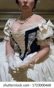 Beautiful girl, in a romantic dress, retro style.View of the cleavage. Historical reconstruction