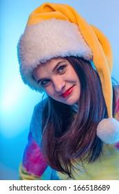 Beautiful girl in Santa Claus hat.