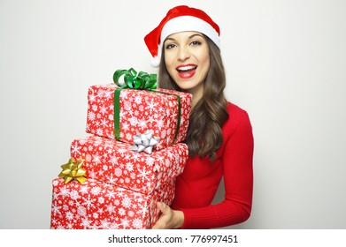 Beautiful girl with Santa Claus hat and red dressed bring gifts on white background