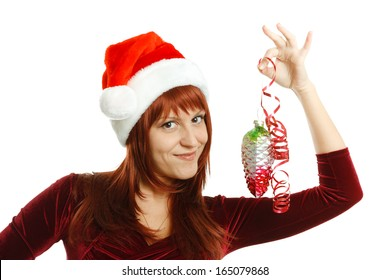 Beautiful girl in Santa hat with a decoration for the Christmas tree on a white background