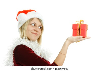 Beautiful girl in Santa hat on white background