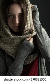 Beautiful girl in a scarf