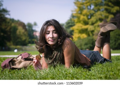 beautiful girl with scarf on the lawn in autumn