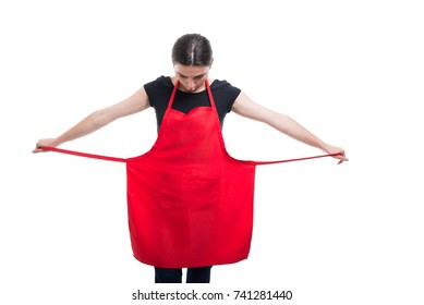 Beautiful girl seller wearing a red apron at her supermarket job isolated on white background