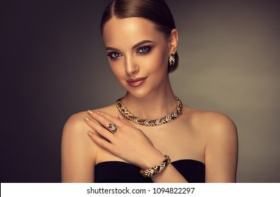 0c3fa51bb8c Beautiful girl with set jewelry . Woman in a necklace with a ring, earrings  and
