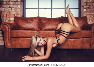 Beautiful girl in sexy posing on couch