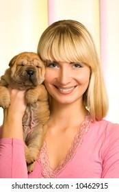 Beautiful girl with sharpei puppy