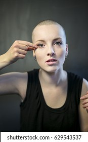 Beautiful girl with shaved head