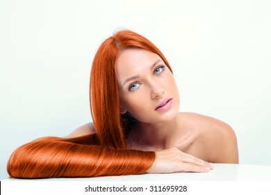 beautiful girl with shiny red hair. fashion model