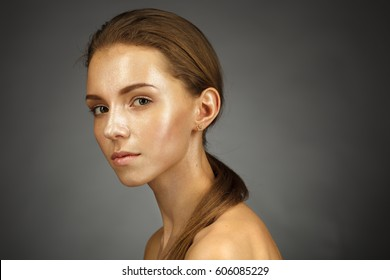 Beautiful girl with shiny skin. Facial and cosmetic treatments