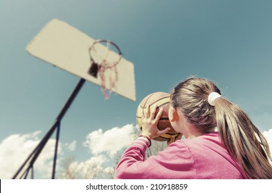 beautiful girl shooting basket and playing basketball, lower view wide angle, VINTAGE
