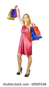 Beautiful girl with shopping bags. Isolated with clipping path