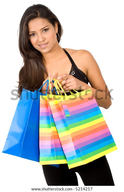 beautiful girl with shopping bags over a white background