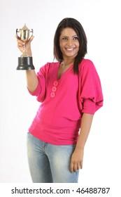 Beautiful girl showing her gold trophy