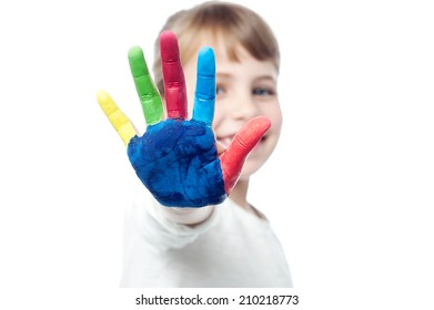 Beautiful girl showing her painted hand to camera