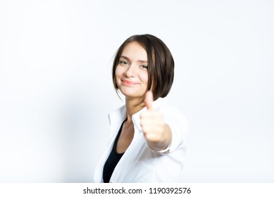 beautiful girl shows a thumbs up sign, like, short haircut, isolated over a white background