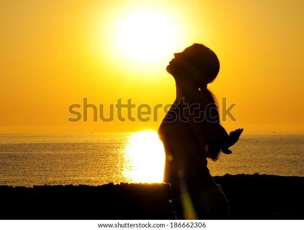 A beautiful girl silhouette free in the sun