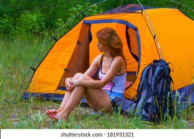 beautiful girl sin near a touristic tent