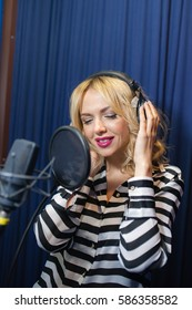 beautiful girl singing in a recording studio