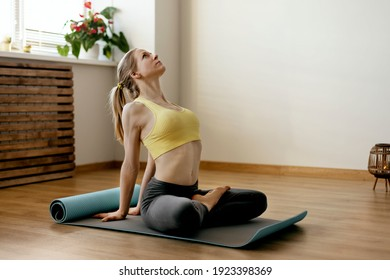 A beautiful girl sits in the lotus position and meditates. Yoga, fitness, meditation. Healthy Lifestyle Concept