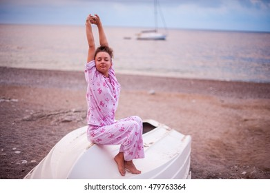 The beautiful girl sits on the boat