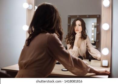beautiful girl sitting in the boudoir
