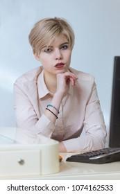 Beautiful girl sitting at the computer at work