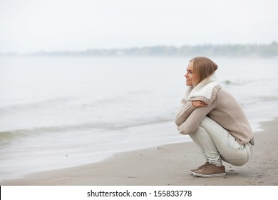 Beautiful girl sitting on the beach