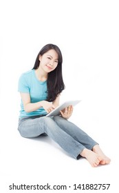 beautiful girl sitting on the floor with tablet computer, isolated on white background