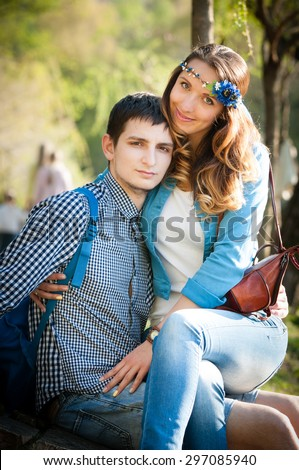 girl sitting in boys lap