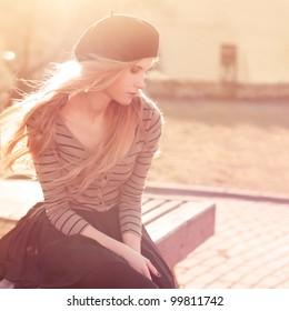 Beautiful girl sitting on a warm sunny day