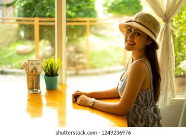 Beautiful girl sitting in a restaurant.