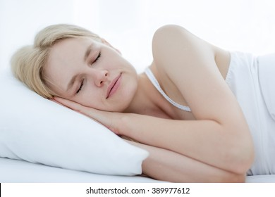 Beautiful girl sleeping in bed.