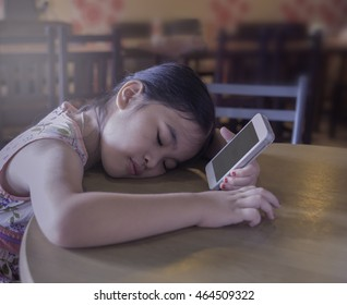 Beautiful Girl sleeping with a smartphone in hand.