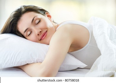 beautiful girl sleeps in the bedroom