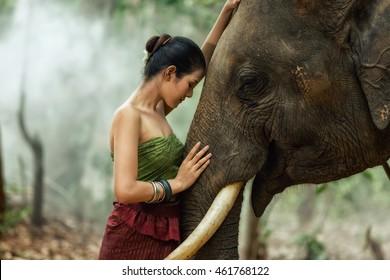 beautiful girl with smiling elephant, elephant village, Surin, Thailand