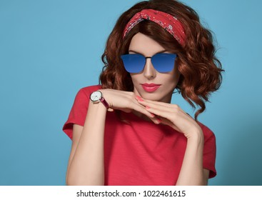 Beautiful Girl in Smiling. Fashion Young Redhead woman, Trendy Sunglasses. Studio Portrait Playful Model in Spring Summer Outfit. Pretty Lady on Blue