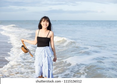 Beautiful girl smiling happily on a sunny day, Hua Hin beach, Thailand