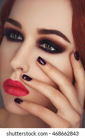 Beautiful girl with smoky eyes and red lips