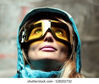 beautiful girl in snowboard mask and ski jacket