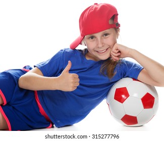 Beautiful girl in a sports cap and a T-shirt with a ball on a white background.