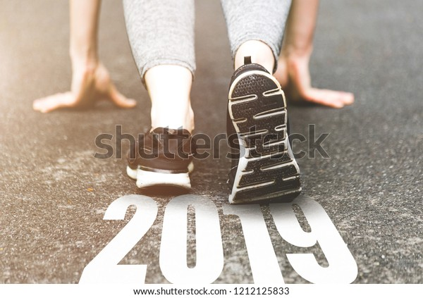 beautiful girl in sports uniform running around. Healthy way of life, an infused figure. sneakers close-up, finish 2018. Start to new year 2019, plans, goals, objectives