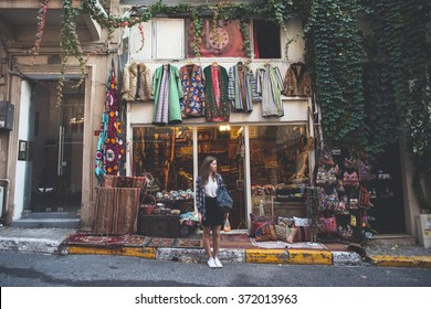 A Beautiful Girl Standing Near Colorful Vintage Store in the District of Cukurcuma in Istanbul, Turkey