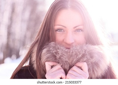 Beautiful girl standing outdoors in winter
