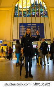 Beautiful girl standing at the train station waiting for her train in Dover,, UK.