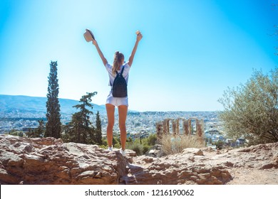beautiful girl stands on the ruins of ancient Greece