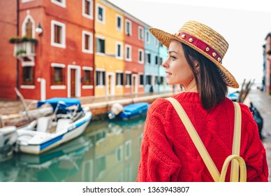 Beautiful girl in a straw hat in Italy